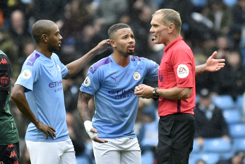 Manchester City's Gabriel Jesus, left, and Manchester City's Fernandinho argue with referee Graham Scott during the English Premier League soccer match between Manchester City and Aston Villa at Etihad stadium in Manchester, England, Saturday, Oct. 26, 2019. (AP Photo/Rui Vieira)