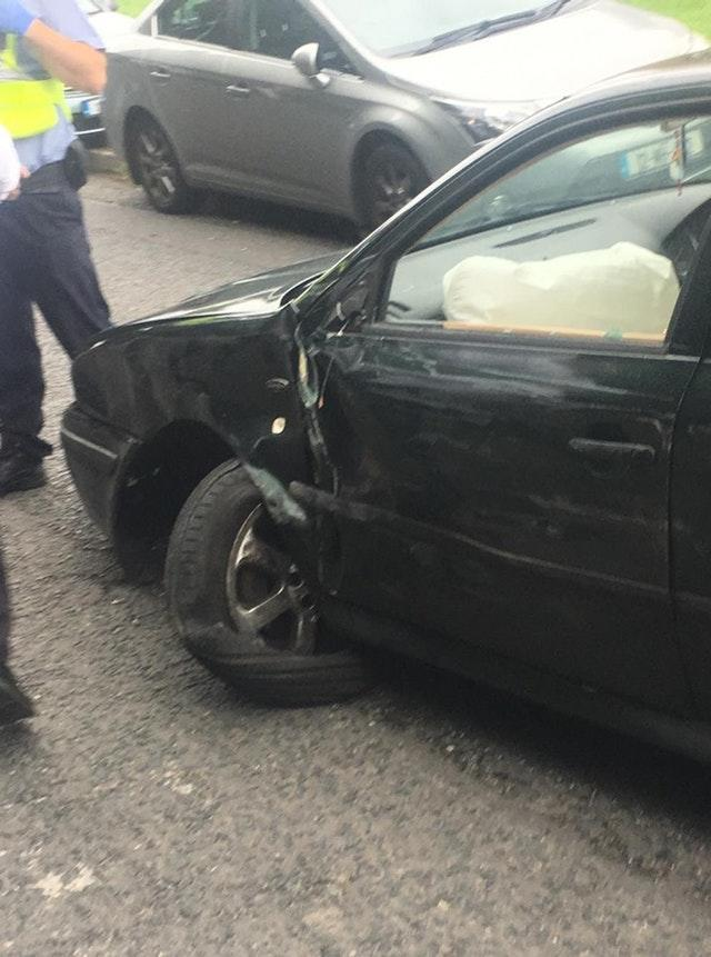 Damage caused to a car after it collided with parked cars near the cemetery