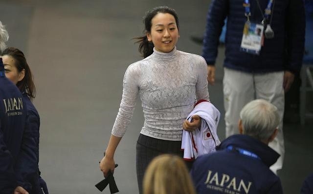 Mao Asada of Japan walks after a practice session at the figure stating practice rink at the 2014 Winter Olympics, Monday, Feb. 17, 2014, in Sochi, Russia. (AP Photo/Vadim Ghirda)