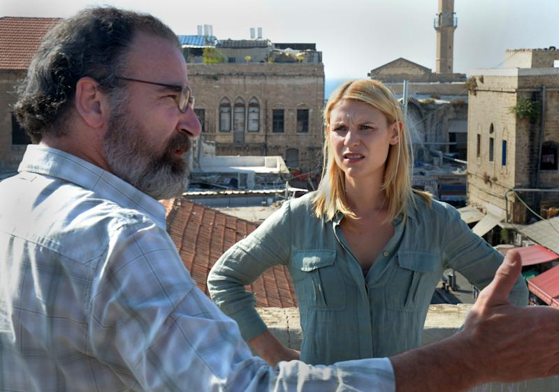 """This undated image released by Showtime shows actors Claire Danes as Carrie Mathison, right, and Mandy Patinkin as Saul Berenson in a scene from the second season of """"Homeland,"""" filmed in Israel. The scene from a recent episode of the hit series """"Homeland,"""" is supposed to be Beirut - but it was shot in Tel Aviv, Israel. And that has some people irritated in both cities. (AP Photo/Showtime, Ronen Akerman)"""