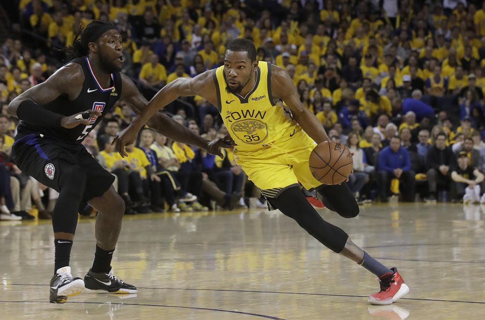 Golden State Warriors forward Kevin Durant (35) drives against Los Angeles Clippers forward Montrezl Harrell (5) during the second half of Game 2 of a first-round NBA basketball playoff series in Oakland, Calif., Monday, April 15, 2019. (AP Photo/Jeff Chiu)