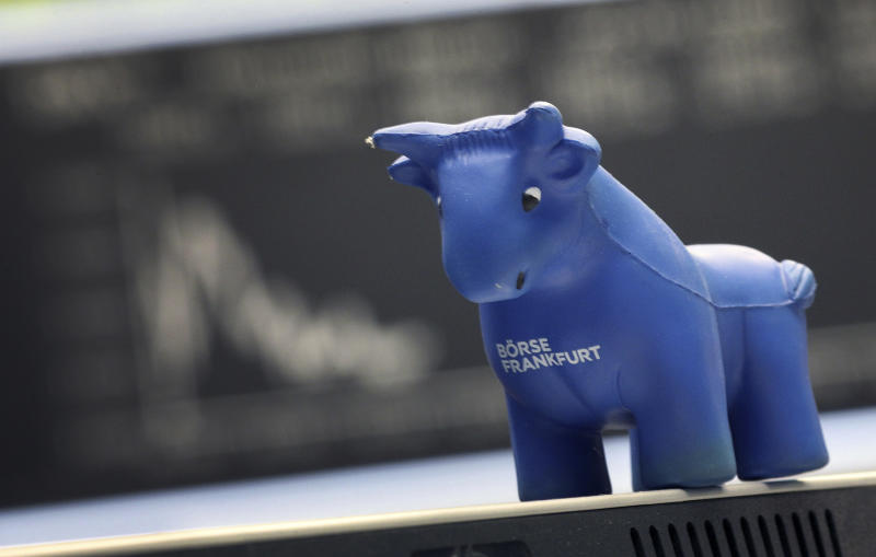 A toy bull stands in front of the chart of Germany's share index DAX at the stock exchange in Frankfurt am Main, western Germany, on January 22, 2020. (Photo by Daniel ROLAND / AFP) (Photo by DANIEL ROLAND/AFP via Getty Images)