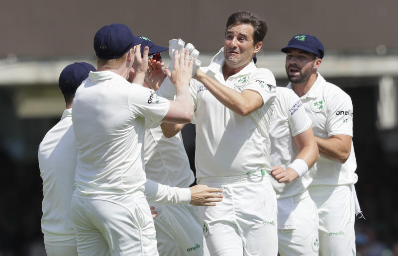 Ireland's Tim Murtagh, second right, celebrates taking the wicket of England's Chris Woakes during the first day of the test match between England and Ireland at Lord's cricket ground in London, Wednesday, July 24, 2019. (AP Photo/Kirsty Wigglesworth)
