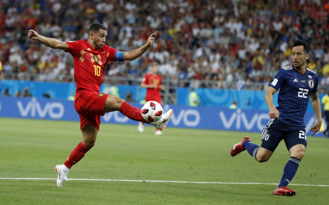 <p>Belgium's Eden Hazard, left, challenges for the ball in front of Japan's Maya Yoshida during the round of 16 match between Belgium and Japan at the 2018 soccer World Cup in the Rostov Arena, in Rostov-on-Don, Russia, Monday, July 2, 2018. (AP Photo/Petr David Josek) </p>