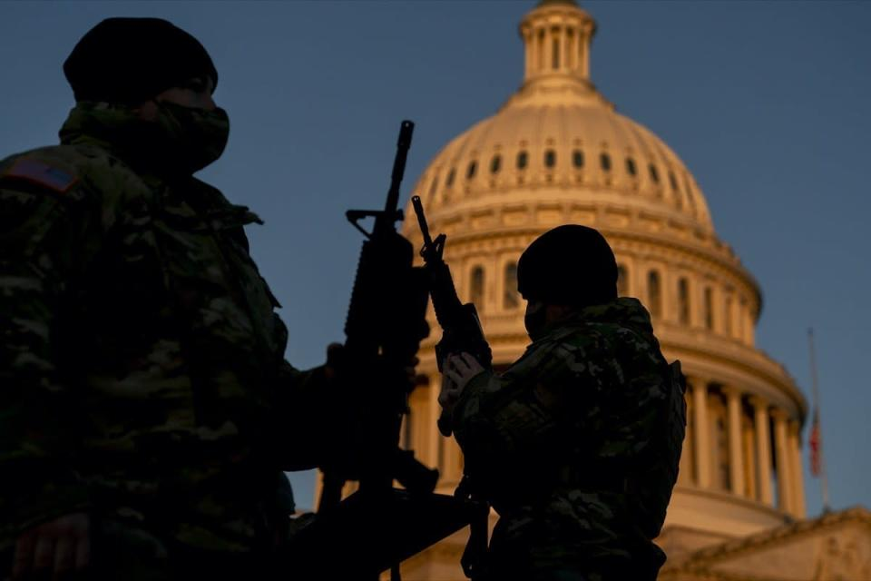 national guard members receiving long guns outside capitol building