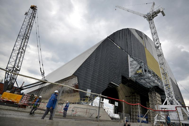 The New Safe Confinement arch pictured at Chernobyl Nuclear Power Plant in Chernobyl, Ukraine on April 22, 2016 (AFP Photo/Genya Savilov)