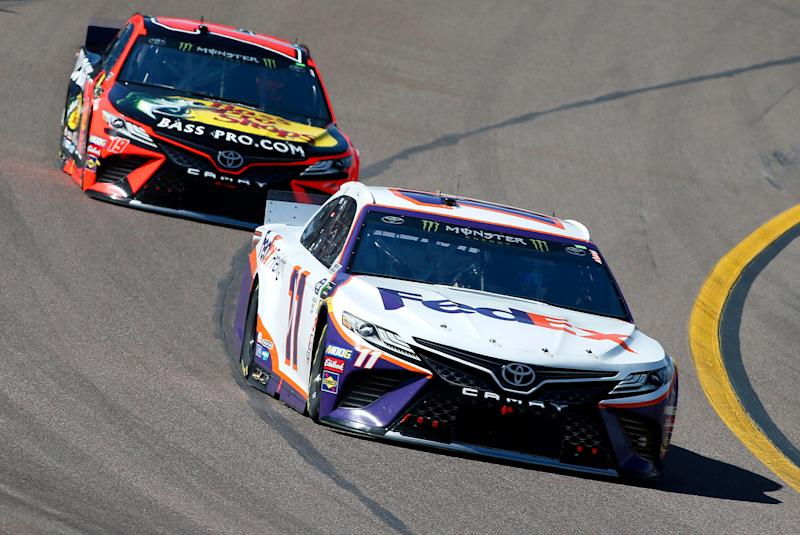 Denny Hamlin (11) drives out of Turn 4 ahead of Martin Truex Jr. (19) during the NASCAR Cup Series auto race at ISM Raceway, Sunday, March 10, 2019, in Avondale, Ariz. (AP Photo/Ralph Freso)