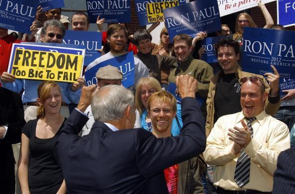 Ron Paul responds to the cheers of supporters at a campaign stop in Exeter, New Hampshire, May 13, 2011. (REUTERS/Brian Snyder)