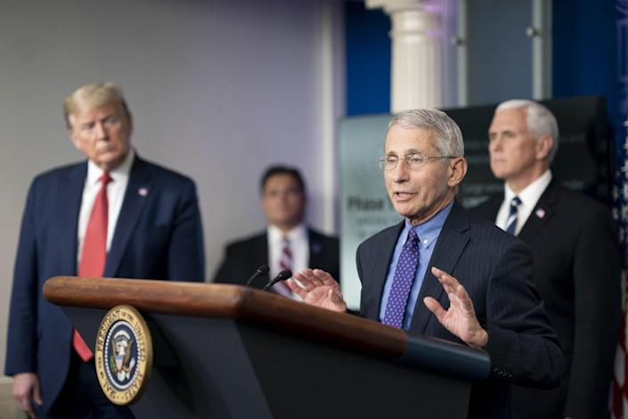 President Donald J. Trump, joined by Vice President Mike Pence, listen as Director of the National Institute of Allergy and Infectious Diseases Dr. Anthony S. Fauci delivers remarks during a coronavirus update briefing.