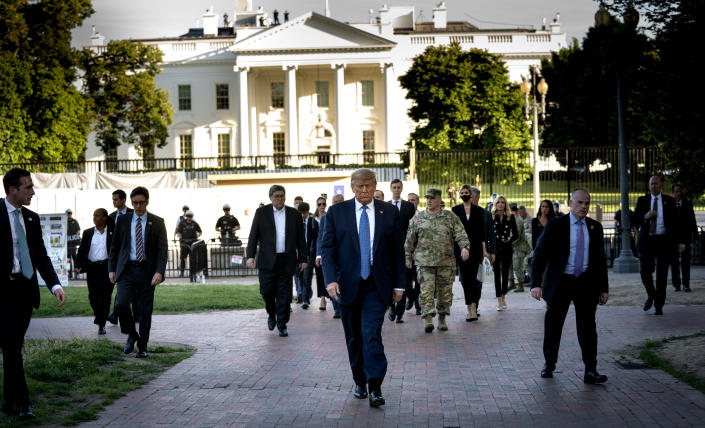 President Donald Trump, along with Gen. Mark Milley, the chairman of the Joint Chiefs of Staff, and other top administration officials walk to St. John's Church in Washington, June 1, 2020. (Doug Mills/The New York Times)