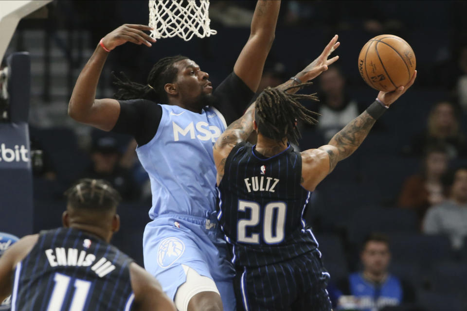 Orlando Magic's Markelle Fultz, right, shoots as Minnesota Timberwolves' Naz Reid defends in the second half of an NBA basketball game, Friday, March 6, 2020, in Minneapolis. (AP Photo/Jim Mone)