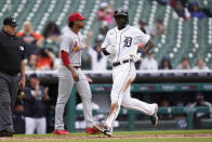 Detroit Tigers' Daz Cameron, right, scores in the eighth inning of a baseball game against the Detroit Tigers in Detroit, Wednesday, June 23, 2021. (AP Photo/Paul Sancya)