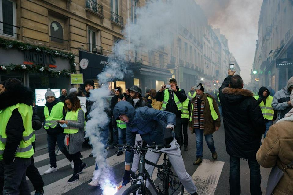 Yellow Jacket protesters in Paris earlier this month (PA)