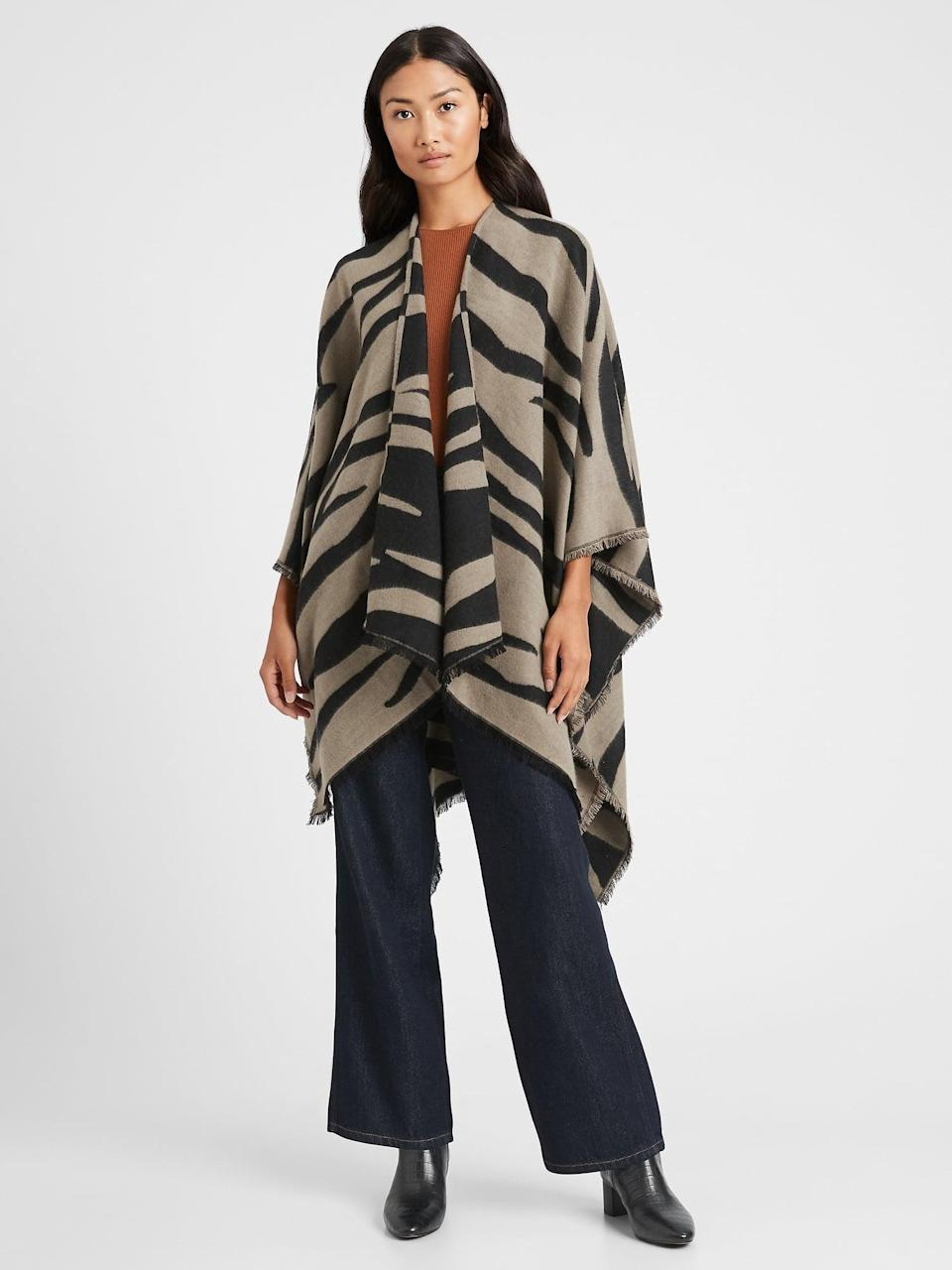 <p>This <span>Banana Republic Reversible Zebra Poncho</span> ($58, originally $98) is a great statement piece with it's graphic print.</p>