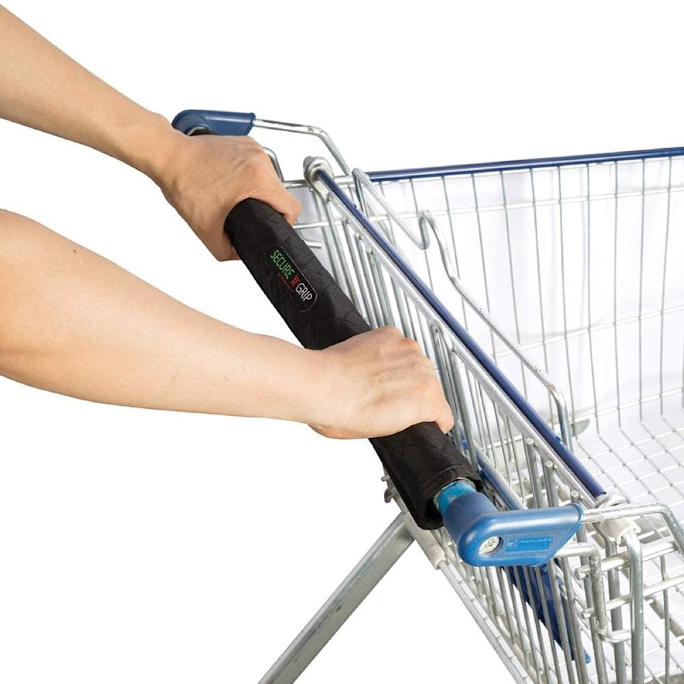 white hands pushing grocery cart