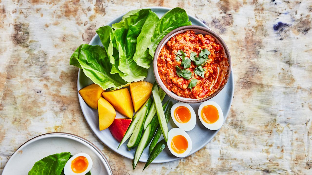 """Nam prik is a chile-based dip found all over Thailand. This version is a riff on nam prik ong, which is typically found in northern Thailand and made with pork or beef. We swapped the meat for cashews; it gives the dip a healthyish twist as well as a smoother, creamier texture. <a href=""""https://www.bonappetit.com/recipe/cashew-nam-prik?mbid=synd_yahoo_rss"""">See recipe.</a>"""