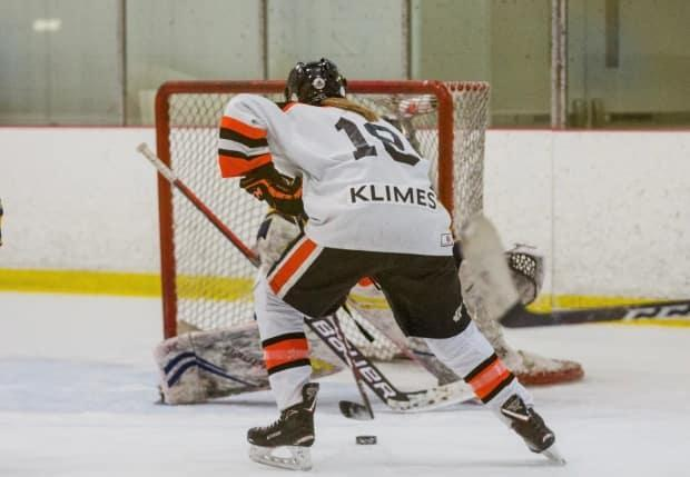 'This year we got to play provincials which was awesome,' says 13-year-old Petra Klimes. 'I always look forward to that, that's king of like the goal at the end of the season to win provincials.'  (Cheryl Perry Photography - image credit)