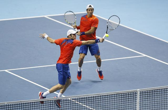 David Marrero of Spain, left and Fernando Verdasco of Spain playa return to Bob Bryan of United States and Mike Bryan of United States during the final of the ATP World Tour Finals doubles tennis match at the O2 Arena in London, Monday, Nov. 11, 2013. (AP Photo/Kirsty Wigglesworth)