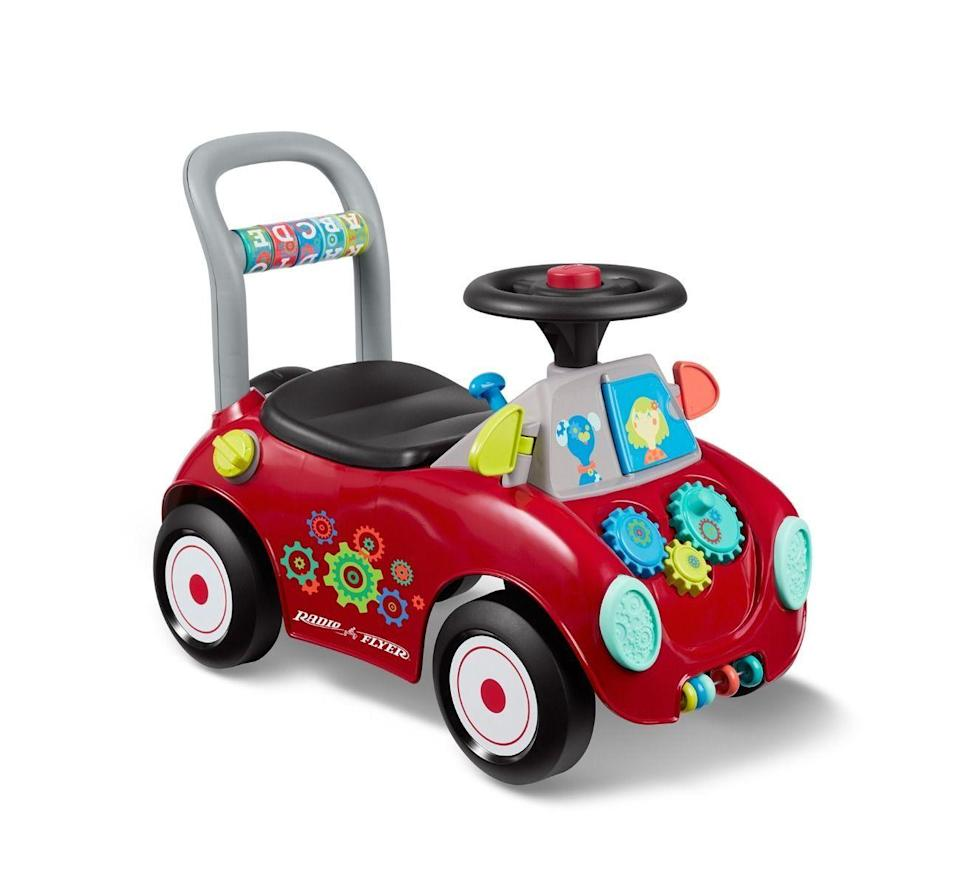 """<p><strong>Radio Flyer </strong></p><p>walmart.com</p><p><strong>$41.45</strong></p><p><a href=""""https://go.redirectingat.com?id=74968X1596630&url=https%3A%2F%2Fwww.walmart.com%2Fip%2F804034942&sref=https%3A%2F%2Fwww.goodhousekeeping.com%2Fchildrens-products%2Ftoy-reviews%2Fg5152%2Fbest-toys-for-one-year-olds%2F"""" rel=""""nofollow noopener"""" target=""""_blank"""" data-ylk=""""slk:Shop Now"""" class=""""link rapid-noclick-resp"""">Shop Now</a></p><p>Beep, beep! While your little one is working on his leg muscle strength, you can still push him around on this <a href=""""https://www.goodhousekeeping.com/holidays/christmas-ideas/g23614294/best-toys-2019/?slide=2"""" rel=""""nofollow noopener"""" target=""""_blank"""" data-ylk=""""slk:2018 Toy Award Winner"""" class=""""link rapid-noclick-resp"""">2018 Toy Award Winner</a>. Then, as he becomes a more confident walker, he can propel himself. There are also <strong>lots of little features that spin, click, and otherwise make noise</strong>. <br></p>"""