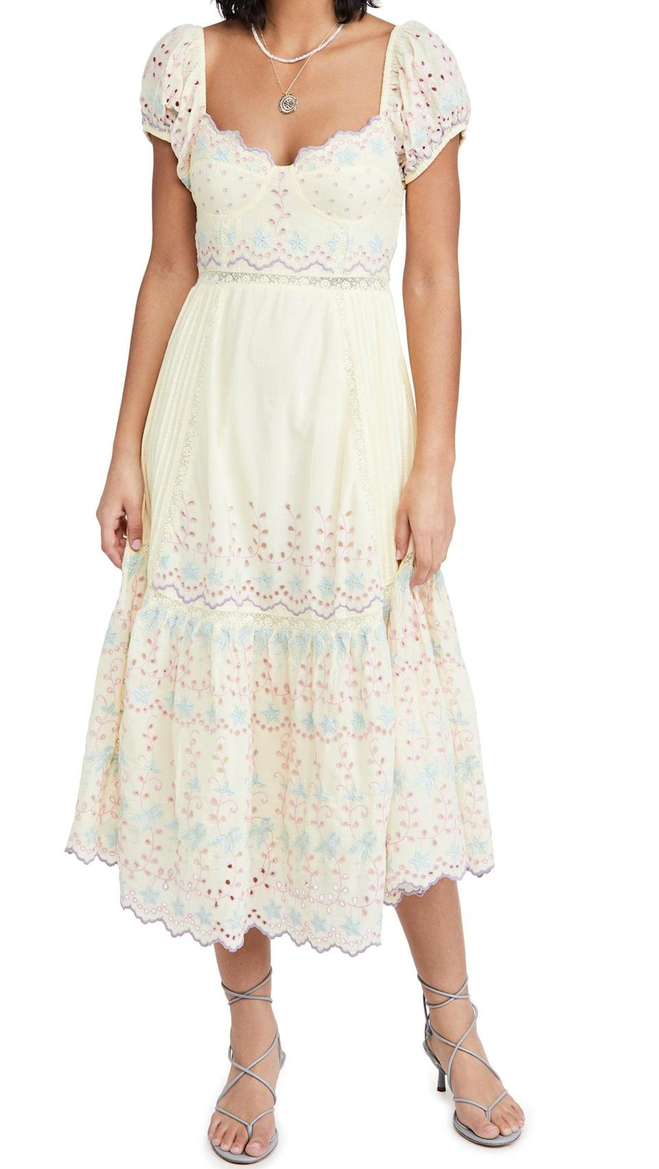 """This breezy midi has all the trappings of a classic LoveShackFancy dress: pastels, lace, and embroidered eyelet. $575, Shopbop. <a href=""""https://www.shopbop.com/magena-dress-loveshackfancy/vp/v=1/1555830841.htm"""" rel=""""nofollow noopener"""" target=""""_blank"""" data-ylk=""""slk:Get it now!"""" class=""""link rapid-noclick-resp"""">Get it now!</a>"""