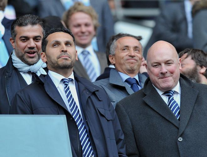 "Manchester City Chairman Khaldoon Al Mubarak (L) watches his team challenge Manchester United in their English Premier League football match at The Etihad stadium in Manchester, north-west England on April 30, 2012. AFP PHOTO/PAUL ELLIS  RESTRICTED TO EDITORIAL USE. No use with unauthorized audio, video, data, fixture lists, club/league logos or ""live"" services. Online in-match use limited to 45 images, no video emulation. No use in betting, games or single club/league/player publications.PAUL ELLIS/AFP/GettyImages"