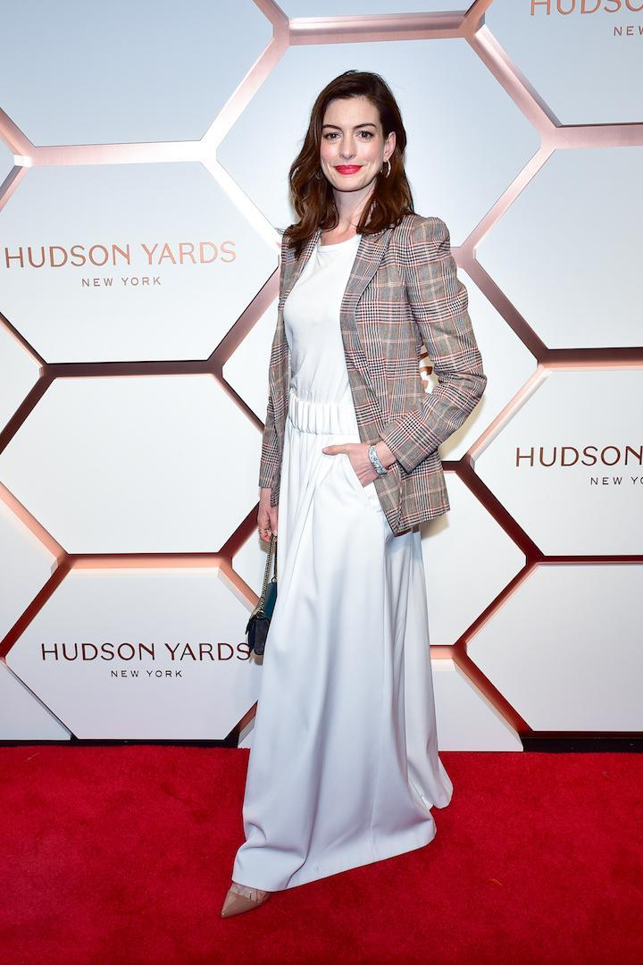 <p>On March 14, Anne Hathaway looked chic in a all-white number finished with a checked blazer and nude courts. <em>[Photo: Getty]</em> </p>