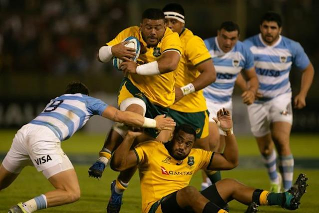 Burly Taniela Tupou (C) had his telephone snatched on a night out in Johannesburg (AFP Photo/Juan José Gasparini)