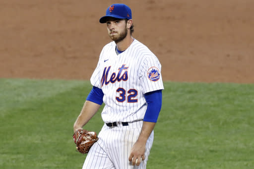 New York Mets starting pitcher Steven Matz reacts after allowing a two-run home run to Washington Nationals' Trea Turner during the third inning of a baseball game Monday, Aug. 10, 2020, in New York. (AP Photo/Kathy Willens)
