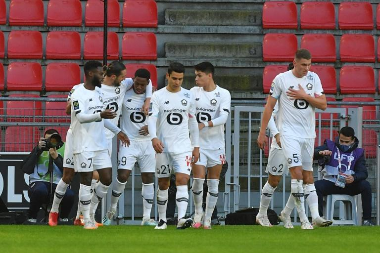 Lille players celebrate after Jonathan David's goal against Rennes as a 1-0 win kept them level on points with Ligue 1 leaders Paris Saint-Germain