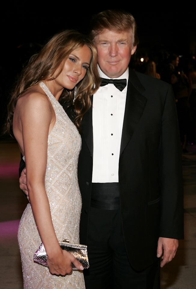 """<p>The newly married Trumps look smitten, with Melania resting her head on Donald's shoulder. The couple's """"I do's"""" were just a month prior, on Jan. 22, 2005. (Photo: Getty Images) </p>"""