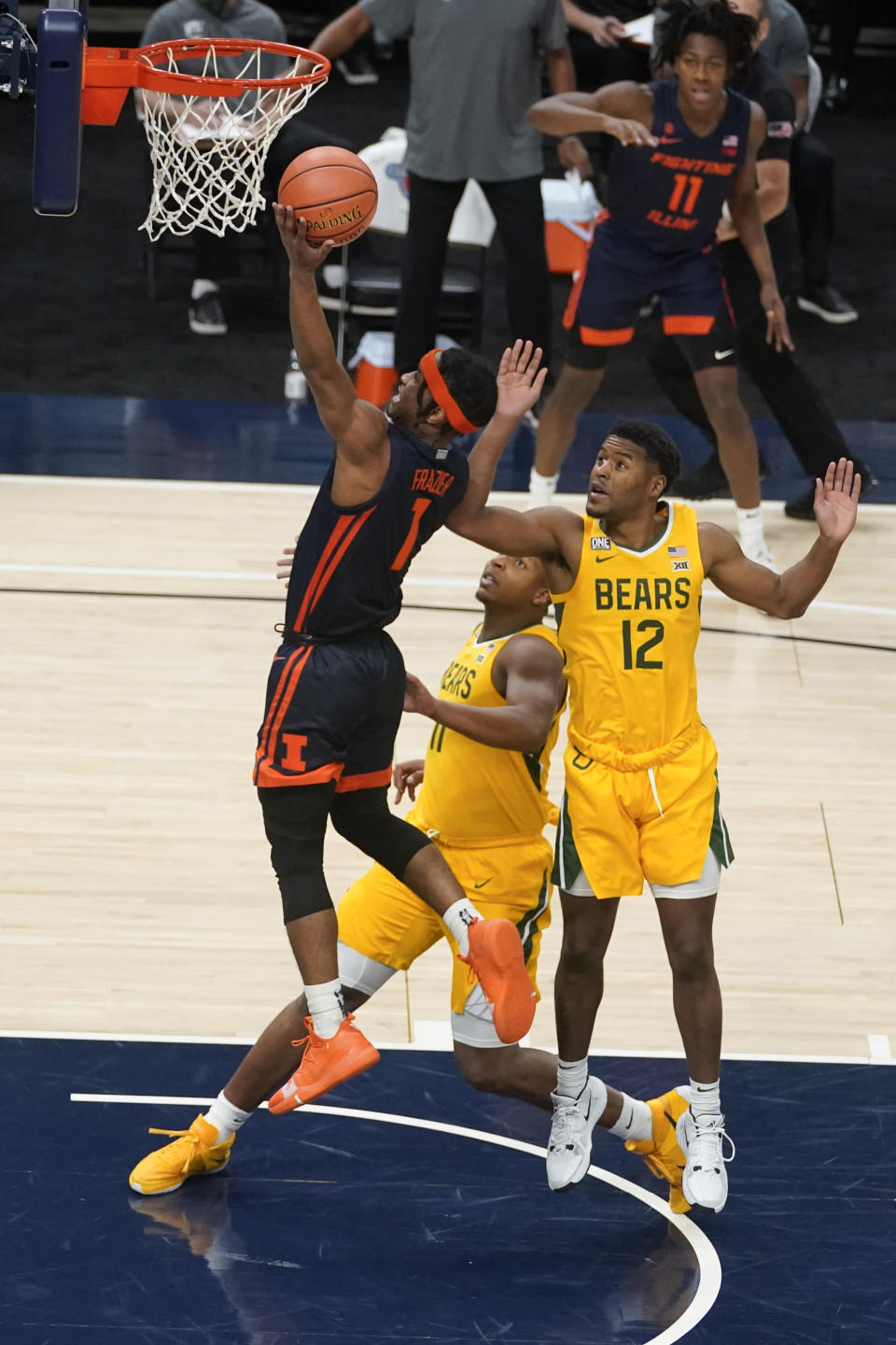 Illinois' Trent Frazier (1) puts up a shot against Baylor's Jared Butler (12) and Mark Vital (11) during the first half of an NCAA college basketball game, Wednesday, Dec. 2, 2020, in Indianapolis. (AP Photo/Darron Cummings)