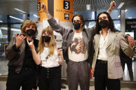 From left, Thomas Raggi, Victoria De Angelis, Damiano David, and Ethan Torchio, of Italian band Maneskin, pose for photographers upon their arrival at Rome's Fiumicino airport, Sunday, May 23, 2021. The glam rock band who got their start busking on Rome's main shopping drag won the Eurovision Song Contest Saturday and brought next year's competition back to the place where Europe's song contests began. (AP Photo/Alessandra Tarantino)