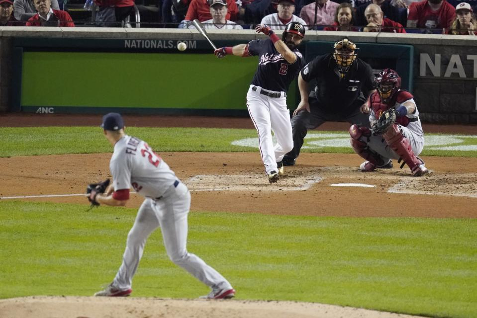 FILE - Washington Nationals' Adam Eaton hits an RBI single off St. Louis Cardinals starting pitcher Jack Flaherty during the third inning of Game 3 of the baseball National League Championship Series in Washington, in this Monday, Oct. 14, 2019, file photo. MLB will experiment with a 12-inch greater distance between the mound and home plate during a portion of the Atlantic League season in an effort to decrease strikeouts and increase offense. The pitching rubber will be moved back to 61 feet, 6 inches starting Aug. 3. (AP Photo/Alex Brandon, File)