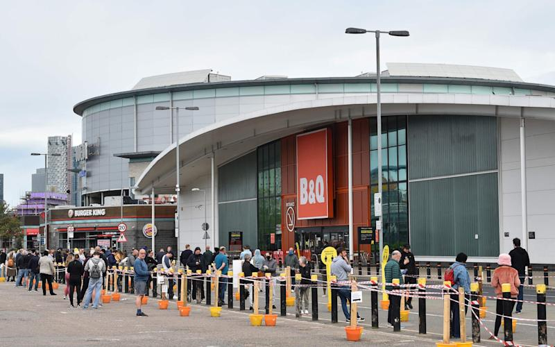 Shoppers queue outside B&Q as store staff manage a one-in-one-out policy - GLYN KIRK/AFP via Getty Images