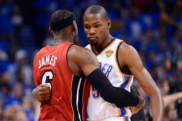 OKLAHOMA CITY, OK - JUNE 12: LeBron James #6 of the Miami Heat hugs Kevin Durant #35 of the Oklahoma City Thunder before the start of Game One of the 2012 NBA Finals at Chesapeake Energy Arena on June 12, 2012 in Oklahoma City, Oklahoma. NOTE TO USER: User expressly acknowledges and agrees that, by downloading and or using this photograph, User is consenting to the terms and conditions of the Getty Images License Agreement. (Photo by Ronald Martinez/Getty Images)