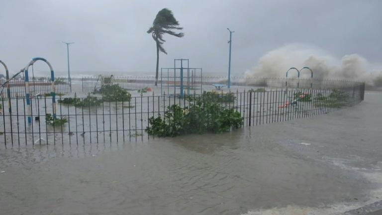 Flooded streets, crashing waves as cyclone hits eastern India