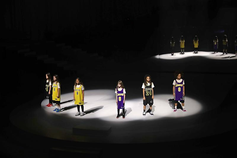NEW YORK, NEW YORK - FEBRUARY 05: Models are seen honoring Kobe Bryant during the 2020 Tokyo Olympic collection fashion show at The Shed on February 05, 2020 in New York City. (Photo by Bennett Raglin/Getty Images)