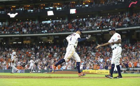 May 23, 2018; Houston, TX, USA; San Francisco Giants starting pitcher Jeff Samardzija (left) reacts as Houston Astros right fielder George Springer (4) celebrates with third base coach Gary Pettis (8) after hitting a home run during the fifth inning at Minute Maid Park. Mandatory Credit: Troy Taormina-USA TODAY Sports