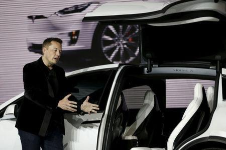 FILE PHOTO: Tesla Motors CEO Elon Musk introduces the falcon wing door on the Model X electric sports-utility vehicles during a presentation in Fremont