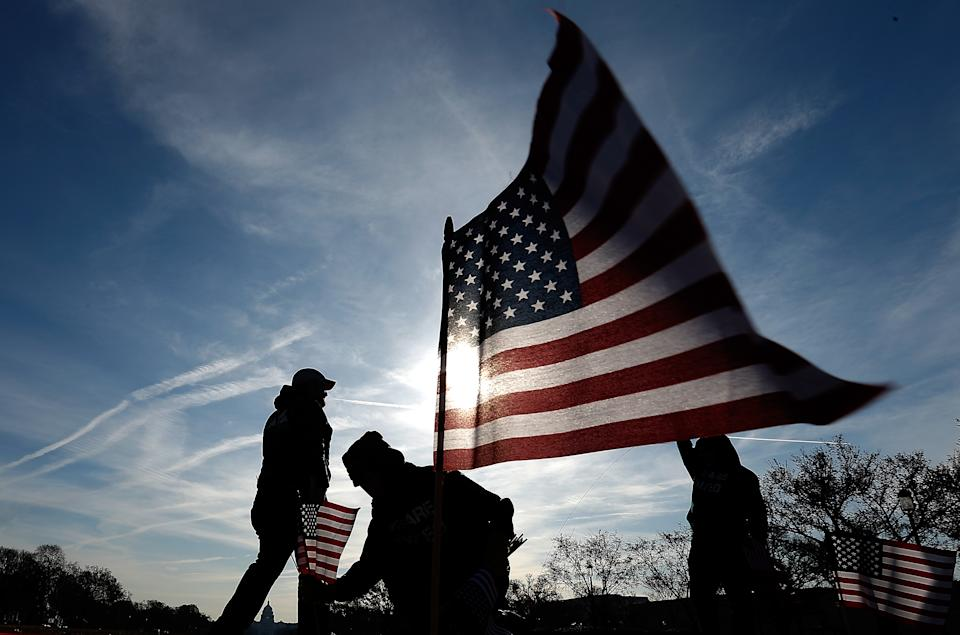 Veterans with American flag. (Getty Images)