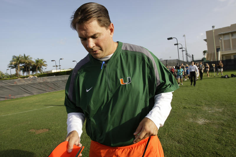 "Miami's head football coach Al Golden walks away following a news conference before football practice in Coral Gables, Fla., Thursday, Aug. 18, 2011. The latest scandalous allegations in college football _ this time at the University of Miami _ have renewed talk by the NCAA of the need for ""fundamental change"" in athletics.  (AP Photo/Lynne Sladky)"
