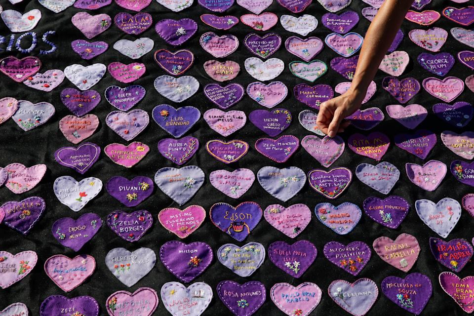 Hearts decorated with the names of Covid-19 victims outside Congress in Brasilia to protest the high death toll (AP)