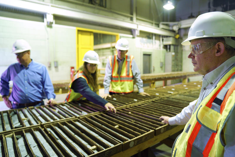 In this Wednesday, May 29, 2019 photo,  Jon Cherry, left, President, CEO and Director at Polymet, Bruce Richardson, Vice President of Corporate Communications and External Affairs, and LaTisha Gietzen, center, Vice-President of Public, Government, and Environmental Affairs, tour the site of the Polymet copper-nickel mine to discuss what's next now that the controversial project has it's major environmental permits in Hoyt Lakes, Minn. (Anthony Souffle/Star Tribune via AP)