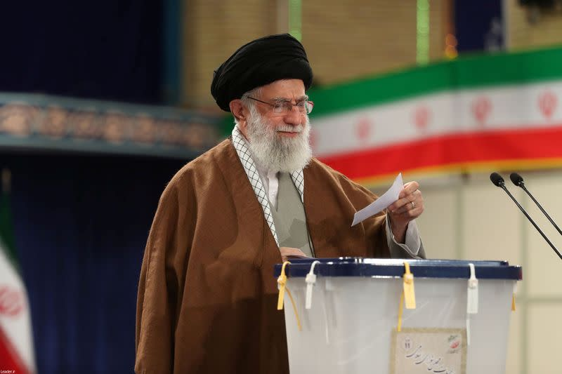 Iran's Supreme Leader Ayatollah Ali Khamenei casts his vote at a polling station during parliamentary elections in Tehran