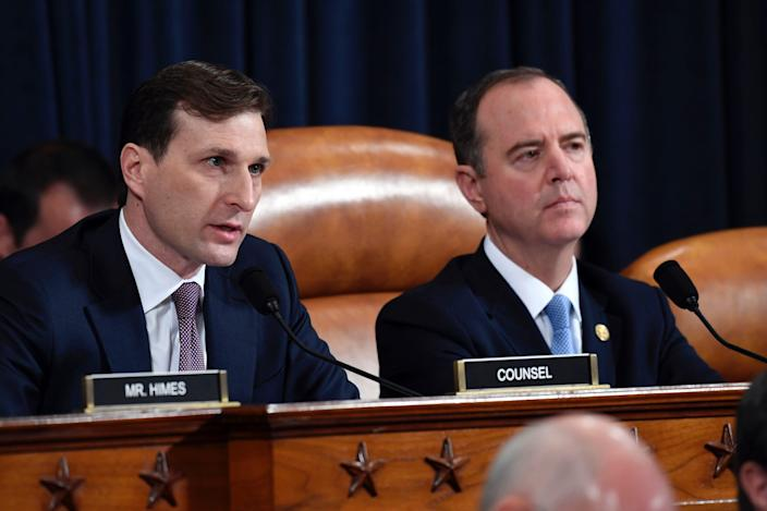 Daniel Goldman, director of investigations for the House Intelligence Committee majority staff, left, asks questions to top U.S. diplomat in Ukraine William Taylor and career Foreign Service officer George Kent, as they testify before the House Intelligence Committee on Capitol Hill.