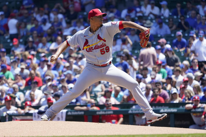 St. Louis Cardinals starting pitcher Johan Oviedo delivers during the first inning of a baseball game against the Chicago Cubs, Friday, June 11, 2021, in Chicago. (AP Photo/Charles Rex Arbogast)