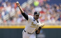 Vanderbilt starting pitcher Kumar Rocker (80) throws against North Carolina State in the first inning of a baseball game at the College World Series, Friday, June 25, 2021, at TD Ameritrade Park in Omaha, Neb. (AP Photo/Rebecca S. Gratz)