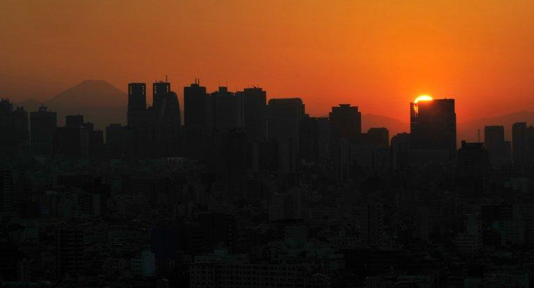 A general view of Shinjuku district in Tokyo, pictured at sunset on October 21, 2012