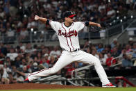 Atlanta Braves starting pitcher Charlie Morton (50) works in the fourth inning of a baseball game against the Philadelphia Phillies Tuesday, Sept. 28, 2021, in Atlanta. The Braves won 2-1 giving Morton the victory. (AP Photo/John Bazemore)