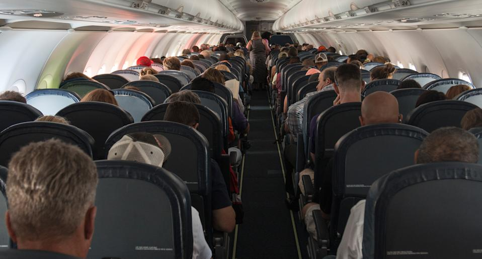 Stock image inside a full flight.